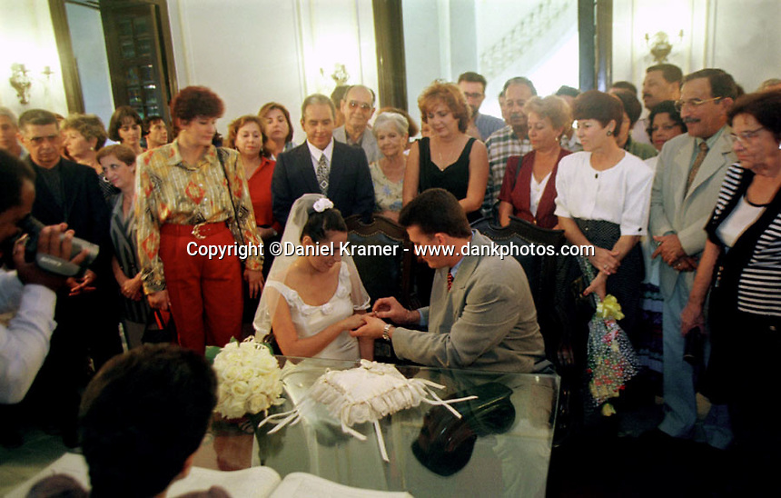 A couple in Havana exchange rings during their civil wedding ceremony in 1999.