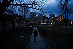 An Albanian man walks through a park on the south side of the Ibar river toward an ethnically mixed enclave on the north side where many Albanians still live...Mitrovica, Kosovo - One-year anniverary of Independence - February 17, 2009.