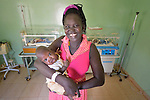 """Achol Malek holds her son Chol Madhol at the St. Daniel Comboni Catholic Hospital in Wau, South Sudan. The boy was born almost three months prematurely in December 2014, yet survived because of the hospital's incubators. His family has nicknamed him """"Comboni."""""""
