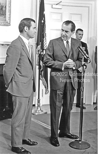 Washington, D.C. - April 21, 1969 -- Director of the Office of Economic Opportunity and Assistant to the President Donald Rumsfeld, left, and United States President Richard M. Nixon, right, in Washington, D.C. on April 21, 1969.<br /> Credit: White House via CNP
