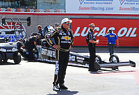 Apr 11, 2015; Las Vegas, NV, USA; NHRA funny car driver John Force looks on prior to daughter Brittany Force making a run in her top fuel dragster during qualifying for the Summitracing.com Nationals at The Strip at Las Vegas Motor Speedway. Mandatory Credit: Mark J. Rebilas-