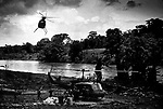 US backed Nicaraguan contras receive supplies at a base camp on the Rio Coca river Honduras on the border with Nicaragua.