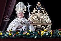 ..Pope Benedict XVI blesses his faithful as he leads his Urbi et Orbi message (to the city and the world) from the central balcony of Saint Peter's Square at the Vatican.. December. 25, 2007