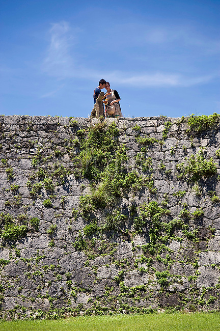 Visitors stand on the ramparts of Zakimi Castle ruins in Yomitan VILLAGE, Okinawa Prefecture, Japan, on May 20, 2012. Built between 1416 and 1422 by the renowned Ryukyuan militarist Gosamaru, Zakimi Castle oversaw the northern portion of the Okinawan mainland. Photographer: Robert Gilhooly