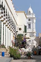Tripoli, Libya - Turkish Ottoman Clock Tower, 19th Century.  Karamanli Mosque on left, Tripoli Medina.