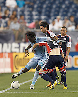 Sporting Kansas City midfielder Kei Kamara (23) works the sideline as New England Revolution defender Chris Tierney (8) pressures. In a Major League Soccer (MLS) match, Sporting Kansas City defeated the New England Revolution, 1-0, at Gillette Stadium on August 4, 2012.