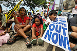 Protestors take a break after marching through the streets of Cagayan de Oro, in the southern Philippines region of Mindanao, on February 18 to protest against the presence of U.S. troops in the war-plagued area. This protest, along with demonstrations in other cities and towns throughout Mindanao, marked the beginning of two weeks of joint U.S. training exercises with the Philippine military. U.S. troops have also operated permanently in Mindanao since 2002 in operations against Muslim insurgents.