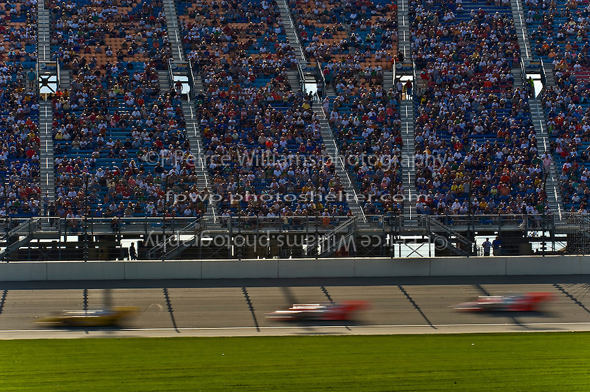 6-7 September 2008, Joliet, Illinois, USA.Tony Kanaan leads Helio Castroneves and Ryan Briscoe past the main grandstand..©F.Peirce Williams 2008.F. Peirce Williams.photography.ref: Capture via Nikon .NEF (RAW)