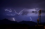 Aug. 21, 2012; Phoenix, AZ, USA: lightning bolt storm monsoon cloud thunderstorm night antenna South Mountain Mandatory Credit: Mark J. Rebilas