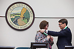 Mayor Fishpaw and former Mayor Carpenter exchange medals with one another Dec. 4.