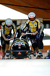 20 November 2005: Martin Annen leads the Switzerland 1 sled pushoff in the first run of the 2005 FIBT AIT World Cup Men's 4-Man Bobsleigh Tour, piloting the team to a 4th place finish at the Verizon Sports Complex, in Lake Placid, NY. Mandatory Photo Credit: Ed Wolfstein.
