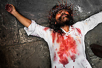 A Peruvian actor Mario Valencia, performing as Jesus Christ, lies on the ground in the Good Friday procession during the Holy week in Lima, Peru, 30 March 2013. The annual Passion Of Christ procession, held as part of Easter celebrations, starts in Lima downtown and, followed by thousands of catholic believers, it climbs to the top of the dry and rocky hill of San Cristobal, where Mario Valencia, who has been playing the role of Jesus Christ for more than 30 years, is symbolically crucified.
