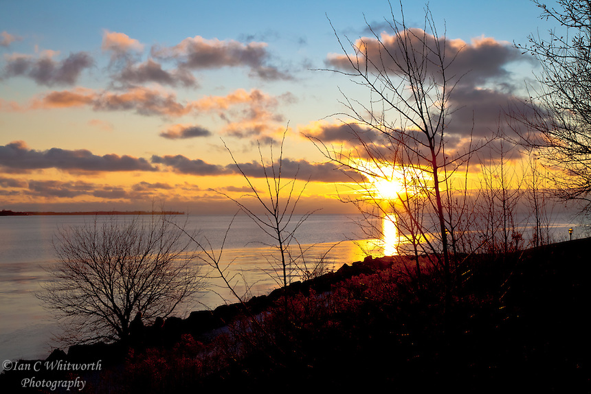 Looking from the shore of Toronto over Lake Ontario at the sunrise