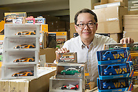 Toyeast Director Steve Ng poses for a phograph surrounded by his models in his offices on 14 April 2016 in Hong Kong, China. Photo by Lucas Schifres