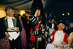 'QUANTOCK STAG HOUNDS', QUANTOCK, SOUTH SOMERSET. THE PIPER SALUTES DURING THE STAG HOUND HUNT BALL, 1997