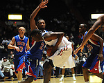 Ole Miss' Reginald Buckner (23) vs. SMU's Shawn Williams (2) at the C.M. &quot;Tad&quot; Smith Coliseum in Oxford, Miss. on Tuesday, January 3, 2012. Ole Miss won 50-48.