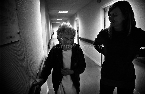 My grandmother had been advised to walk a minimum amount- in order to prevent disability through a lack of circulation. Therefore, whenever we visited her we would encourage her to walk in the hospital corridors - some days she was very willing but on bad days she was stubborn and.completely refused...© Magali Corouge/Documentography.2004-2006.France.