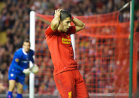 LIVERPOOL, ENGLAND - Thursday, October 4, 2012: Liverpool's Luis Alberto Suarez Diaz rues a missed chance against Udinese Calcio during the UEFA Europa League Group A match at Anfield. (Pic by David Rawcliffe/Propaganda)