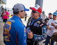 Oct 16, 2016; Ennis, TX, USA; NHRA funny car driver John Force (right) talks to Ron Capps during the Fall Nationals at Texas Motorplex. Mandatory Credit: Mark J. Rebilas-USA TODAY Sports