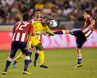 Columbus Crew forward Emilio Renteria (20) lowers his head into the foot of Chivas USA midfielder Ben Zemanski (21). CD Chivas USA defeated the Columbus Crew 3-1 at Home Depot Center stadium in Carson, California on Saturday July 31, 2010.