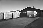 Dallas, Texas neighborhood with garage and travel trailer. 1975
