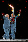 The parents of Canadian ledged, Terry Fox walk the Paralympic Flame into BC Place during the opening ceremonies in Vancouver.