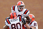 2 September 2006: Syracuse's Rice Moss (center) accepts congratulations from teammates following his 1st quarter touchdown reception from Perry Patterson (not pictured) to tie the game 7-7. Wake Forest defeated Syracuse 20-10 at Groves Stadium in Winston-Salem, North Carolina in an NCAA college football game.