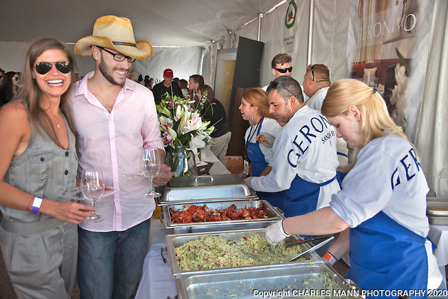 The 2011 Santa Fe Wine & Chile Fiesta brought together local Santa Fe restaurants and wineries from all over the country to serve hundreds of visitors who sampled wine and food under ideal September skies. Local favorite Geronimo's served up goodies to a host of visitors.