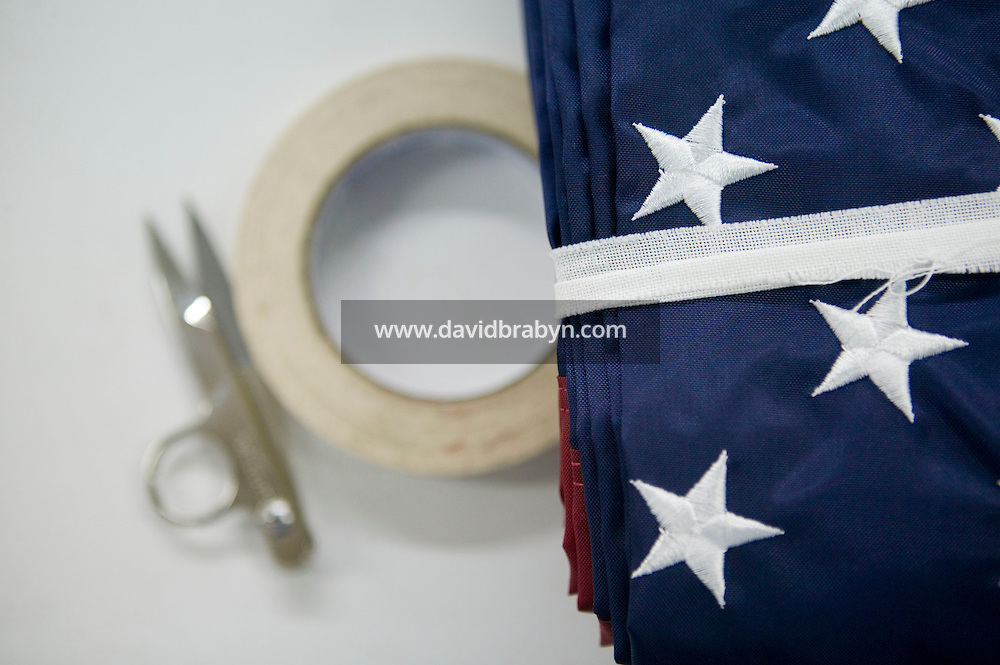 21 June 2005 - Oaks, PA - A pair of thread nippers and tape lie beside a tied up American flag at the Annin & Co. flag manufacturing plant in Oaks, PA. Photo Credit: David Brabyn.