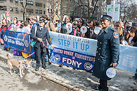 Women FDNY firefighters participate in the March for Gender Equality and Women's Rights on International Women's Day in New York on Sunday, March 8, 2015. The march, co-hosted by the U.N. and NYC with NGO organizations, traveled from the United Nations to Times Square and called for gender equality across multiple platforms including pay, the glass ceiling and political representation. (© Richard B. Levine)