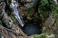 Rappel at Burac&atilde;o waterfall near Ibicoara, Chapada Diamantina, Bahia state, Brazil.
