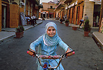 00660_14, Beqaa Valley, Lebanon, 2005, LEBANON-10074. A young girl stops and poses with her bike.