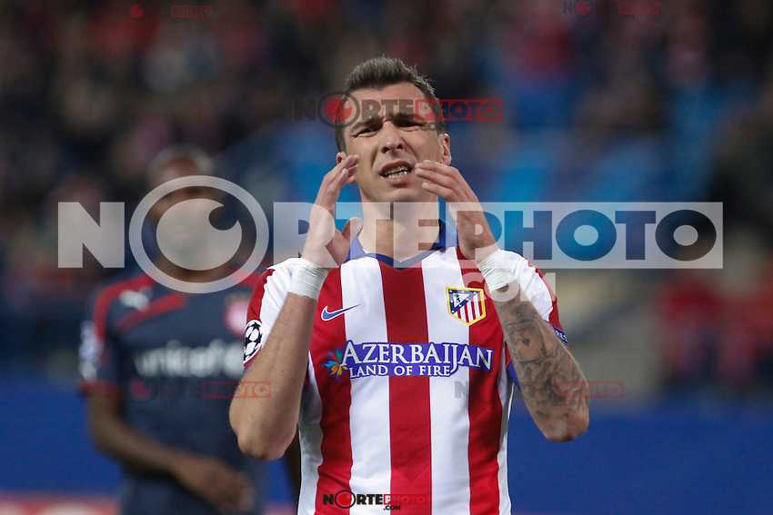 Atletico de Madrid´s Mandzukic regrets missing a goal opportunity during Champions League soccer match between Atletico de Madrid and Olympiacos at Vicente Calderon stadium in Madrid, Spain. November 26, 2014. (ALTERPHOTOS/Victor Blanco) /NortePhoto