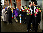 March 03, 2004 -- Multnomah County begins to issue marriage licenses to same sex couples, some getting married just outside the offices. (LtoR) Steven Hansen and Rick Raymen of Portland , both dressed to the hilt in tuxes, share a kiss while waiting in the rain for their chance to apply. ..Keywords: gays, weddings, certificates