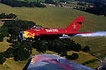 Bill Reesman pilots his Red BUll  MiG 17 as part of a practice flight in preparation for the airshow this weekend at the Hillsboro Airport.