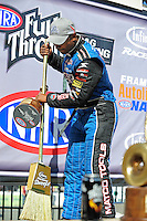 Jul. 26, 2009; Sonoma, CA, USA; NHRA top fuel dragster driver Antron Brown celebrates with a broom after winning the Fram Autolite Nationals at Infineon Raceway. The win was the third win in a row for Brown. Mandatory Credit: Mark J. Rebilas-