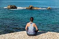 Women doing yoga, Negril, Jamaica.