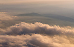 Aerial view over clouds looking west over Virginia's Shenandoah Mountains and Valley at Sunset