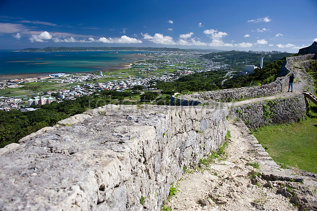 Visitors enjoy the view from the ramparts of the 2nd  enclosure of Nakagusuku Castle ruins in KITA-NAKAGUSUKU VILLAGE, Okinawa Prefecture, Japan, on May 20, 2012. Photographer: Robert Gilhooly