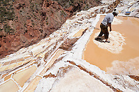 Woman working at the salt pans near Maras, Peru.  The pans are fed by a natural spring and the salt has been collected since pre-Inca times.