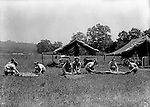 East McKeesport PA:  On Location photography for the Pittsburgh-area Girl Scouts. Girl Scouts rolling up their tents and sleeping bags at Camp Youghahela - 1925