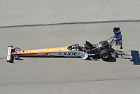 Sept. 29, 2012; Madison, IL, USA: NHRA top fuel dragster driver Clay Millican being towed back to the pits during qualifying for the Midwest Nationals at Gateway Motorsports Park. Mandatory Credit: Mark J. Rebilas-