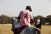 A Royal Jaipur Polo Team player during a game between the Royal Jaipur Polo Team (in pink) and the Western Australia Polo Team (in black) for the Argyle Pink Diamond Cup, organised as part of the 2013 Oz Fest in the Rajasthan Polo Club grounds in Jaipur, Rajasthan, India on 10th January 2013. Photo by Suzanne Lee