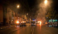 Roma  15 Ottobre 2011.Manifestazione contro la crisi e l'austerità.Scontri tra manifestanti e forze dell'ordine.Cassonetti dati alle fiamme in Piazza Vittorio.