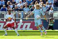 Sporting KC defender Chance Myers (7) watched by Roy Miller, Red Bulls defender...Sporting Kansas City defeated New York Red Bulls 2-0 at LIVESTRONG Sporting Park, Kansas City, Kansas.