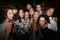 September 23, 2007; Patras, Greece;   Many gymnasts from Spain (mostly) posing for fun group photo at banquet after 2007 World Championships Patras. (L-R) Nuria Artiguez, Elizabeth Salom, Veronica Ruiz, Isabel Pagan, Barbara Gonzalez(in back), Carolina Rodriguez, Almudena Cid, Ana Maria Pelaz (in back), Loreto Achaerandio, Anahi Sosa (Argentina). Photo by Tom Theobald.
