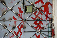 A migrant seeks legal advice at the Athens office of the Greek Council for Refugees. The door of the office has been painted with swastikas and graffiti. According to UNHCR, 38,992 immigrants arrived in Greece in the first 10 months of 2010, whereas in 2009 the number was only 7,574.