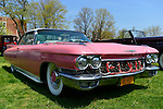The word Elvis is spelled out in red tubing on the front grille of this pink 1960 Cadillac sedan at the Antique Auto Show, where New York Antique Auto Club members exhibited their cars on the farmhouse grounds of Queens County Farm Museum.