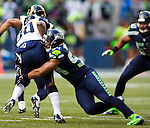 Seattle Seahawks  linebacker Bobby Wagner (54) tackles St. Louis Rams running back Zac Stacy (30) during the quarter  at CenturyLink Field in Seattle, Washington on December 28, 2014.  The Seahawks officially wrapped up the No. 1 seed in the NFC playoffs shortly after beating the Rams, 20-6. Despite the Cowboys and Packers also winning to finish 12-4, the Seahawks (12-4) won the multi-team tiebreaker and earned home-field advantage throughout the playoffs for the second consecutive season.  ©2014. Jim Bryant Photo. All Rights Reserved.