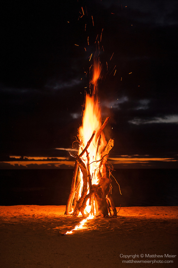Rakiraki, Viti Levu, Fiji; a bonfire on the beach at sunset